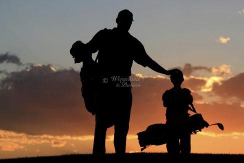 far og sønn solnedgang